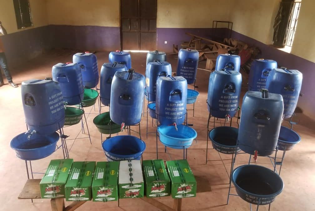 Installing hand-washing stations in the village of Musima